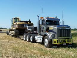 KW TriAxle Moving A CAT Excavator On 3 Axle RGN..... | Heavy Haul ... Ab Big Rig Weekend 2011 Protrucker Magazine Canadas Trucking Eagle Express Lines Jobs Best Image Konpax 2017 Rapp Bros Pallet Service Inc Family Owned Operated Since 1877 Fanelli Brothers Pottsville Pa Rays Truck Photos I40 Sb Part 4 Leavitts Freight Freightliner Argosy With Oversize Beams Auto Transport Llc Wind Gap Back End Of A Double Dump Truck Dumping Youtube Prosecutors Blast Unprecented Inapopriate Request From Classic Automotive History The Rise And Fall Of American Coe Beam Indictment Dnronlinecom
