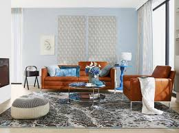 Contemporary Living Dining Room Design With Rust And Blue Accents