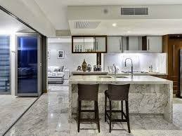 Pretty Kitchen Dining Room Combinations Design Ideas With White Marble Island Table And Black Wooden High Stools Also Arch Faucet Plus Under Cabinet