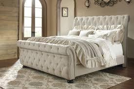 Willenburg Linen King Upholstered Sleigh Bed from Ashley
