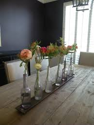 Modern Dining Room Design With Minimalist Floral Table