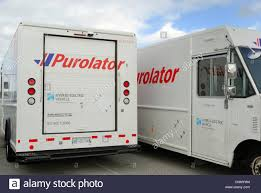 Purolator Hybrid Delivery Trucks Stock Photo: 47789424 - Alamy Transportation Trucks In Freight Delivery Company With Forklift Amazoncom Daron Ups Pullback Package Truck Toys Games The Fairfax Companies Get A Driver And Truck From 30 Home New Peterbilt Tfa Insider Deutsche Post Dhl To Deploy Selfdriving Delivery Trucks By 2018 Anith One Of Twenty Salson Logistics Freightliner M2 Route Next Big Thing You Missed Amazons Drones Could Work Nestle Waters Adds 155 Propanepowered Ngt News Fileinrstate Batteries Kenworth Trucksjpg Wikimedia