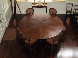 Expandable Round Vintage Dining Room Table With 6 Antique Chairs For Small Spaces Dark Brown Hardwood Floor Tiles And White Wall Interior