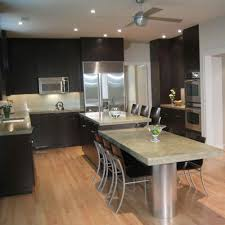 dark cherry cabinets wood flooring kitchen tile backsplashes
