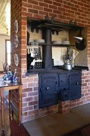 Brick Wall Decor For Rustic Kitchen Ideas With Dark Black Metal Stove
