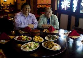 The Flint Journal Owners Of Empress China Restaurant Lin Yang 46 And His Father Ping 71 Pose For A Photo In Their Friday