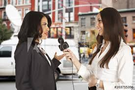 A Reporter With Microphone Interviews Woman In New York City News Van