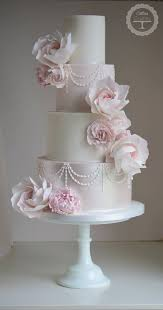 Featured Cake Cotton and Crumbs Sophisticated four tier white and pink wedding cake with