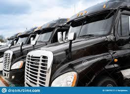 100 18 Wheeler Trucks Fleet Of Black Semi Stock Image Image Of Mandate