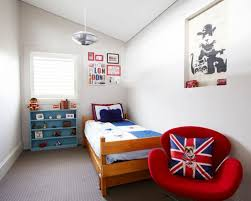 Example Of A Trendy Boy Carpeted Kids Bedroom Design In London With Gray Walls