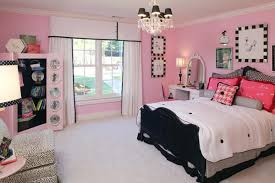 Marvelous Chandelier Above Black Bed And White Duvet Inside Spacious Pink Bedroom Ideas