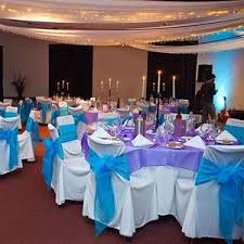 I Love The Purple Table Cloths With Light Blue Sashes On Chairs