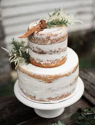 A Semi Naked Winter Wedding Cake Topper With Herbs And Leather For Rustic Celebration
