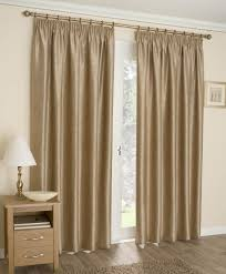 Noise Reducing Curtains Uk by Ready Made Tape Top Blackout Curtains Gold