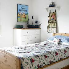 Boys Bedroom With White Chest Of Drawers And Hanging Storage