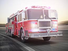 Fire Truck Running With Lights And Sirens A Street With Motion