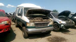 Early 90s Ford Econoline Conversion Van At The Junk Yard