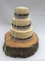 Rustic Wedding Cake White Chocolate Ganache With Hessian Ribbon Lace And Pearls 468 GBP250 6810 GBP330 681012 GBP430