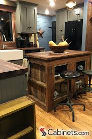 Industrial Counter Stools Next To A Reclaimed Wood Kitchen Island Is Classic Rustic Style
