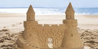 Beautifully Finished Sandcastle On Beach With Seashell