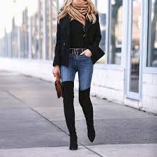 Helena Glazer Is Seen Here In A Pair Of Striking Thigh High Boots Worn Over