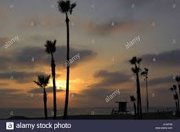 Sunset On Newport Beach Southern California With Silhouetted Palm Trees And Lifeguard Hut