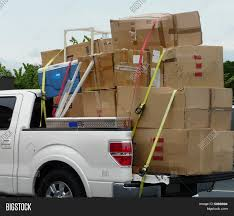 Truck Moving Boxes Image & Photo (Free Trial) | Bigstock Big Truck Moving A Large Tank Stock Photo 27021619 Alamy Remax Moving Truck Linda Mynhier How To Pack Good Green North Bay San Francisco Make An Organized Home Move In The Heat Movers Free Wc Real Estate Relocation Cboard Box Illustration Delivery Scribble Animation Doodle White Background Wraps Secure Rev2 Vehicle Kansas City Blog Spy On Your Start Filemayflower Truckjpg Wikimedia Commons