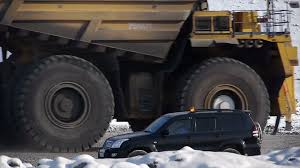 Stock Video Footage Mining Dump Truck Huge Dumper Winter Frost Stock ... Big Dump Truck Is Ming Machinery Or Equipment To Trans Tonka Classic Steel Mighty Dump Truck 354 Huge 57177742 Goes In The Evening On Highway Stock Photo Picture Minivan Stiletto Family Holidays Green Photos Images Alamy How Vehicle That Uses Those Tires Robert Kaplinsky Huge Sand Ez Canvas Excavator Loads 118 24g 6ch Remote Control Alloy Rc New Unturned Bbc Future Belaz 75710 Giant Dumptruck From Belarus Video Footage Dumper Winter Frost