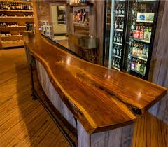A Liquor Store In Canton, Baltimore Had Maryland Wood Countertops ... Reclaimed Longleaf Pine Wood Countertop Photo Gallery By Devos Handmade Custom 11 Foot Long Live Edge Walnut Bar Top Teraprom Options Joints For Mulsection Tops Wood Desk Tops Butcherblock And Blog Jatoba Woodworking Solid Edge Grain Pecan Counter With Butt Joint D S Countertops Gallerylaminate Zinc Metal Home Slab Glassproducts