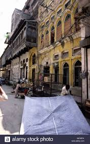 Pakistan Rawalpindi Rajah Bazaar Man Erecting Awning Amongst Old ... The Awning Man Serving Nyc Wchester And Conneticut Commerical Awnings Johnson City Tnbristol Tnvaawning Ae Awning Bromame Foodstall Standing By Pillar Of Brown Sugar Palm New Manual Alinium Retractable Canopy Garden Patio Sun In White Hat Under Window Free Images Imaiges Enclosures Company For Home Uk In Wigan Lancashire Bring You