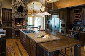Rustic Kitchen Present Large Island With Cook Top Idea And Rock Fireplace Design Also Pretty Track