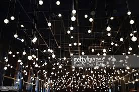 low angle view of light bulbs hanging at restaurant stock photo