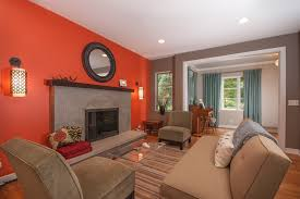 burnt orange wall paint living room contemporary with accent wall