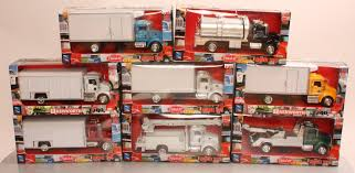 Buy New Ray 1/43 Scale Die-Cast Trucks (8) LN/Box | Trainz Auctions Newray 132 Scale Peterbilt Red Bull Ktm Race Team Truck Die Cast Newray Patriot Missiles 60 Launcher End 42520 1110 Am Newray Kawasaki Two Factory Gift Set Dc 379 Tow By New Ray Nryss12053 Toys Transporter 143 Diecast Single Dump W Wheel Loader Diecast New Ray Rch Suzuki Bevro Intertional Webshop 389 Cab Toy For Kids Youtube The Lvo Vn780 Semi With Trailer Long Hauler 14213