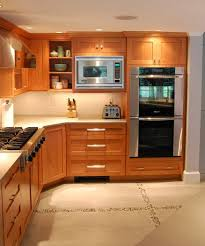 white countertops with cherry cabinets cherry cabinets quartz