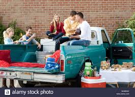 Friends Having A Tailgating Party In The Back Of A Pickup Truck ... Tailgating Truck Best Image Kusaboshicom Ultimate Vehicle Imagimotive Top 10 Vehicles Charleston Beer Works Tailgate Grills For Trucks In 82019 Bbq Grill Truck 1czc 733 Youtube Lsu Fire Blakey Auto Plex Dealership Blog Guide To Hottest 2016 Wheelfire Rivals Season 7 Osu Ride 1941 Flatbed Pickup Idea Ever Tailgating Convert Your Tractor Supply Custom Tailgaters The Vanessa Slideout Kitchen Is Next Level Insidehook Tv Archives Big Game Trailers