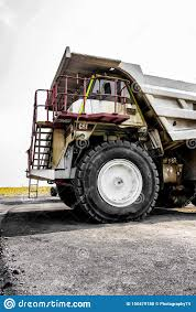 100 Large Dump Trucks Transporting Coal Ore For Processing