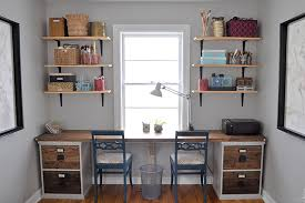two person desk built from filing cabinet bases with a wood