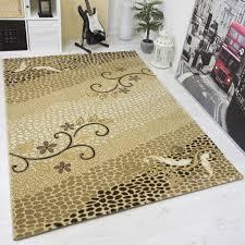 moderner designer teppich in gold beige glitzer effektfaser vimoda homestyle