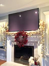 Primitive Decorating Ideas For Fireplace by Mantle Decoration For Christmas With A Big Screen Tv Mantle