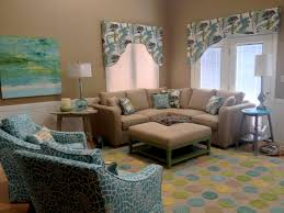Great Room Make Over Company C Rug Tropical Fabric Accent Swivel Chairs Ottoman Table