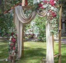 Beautiful Wedding Ceremony Backdrop Arbor With Draping Flowers And Lantern Accents