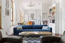 Studio Apartment Interior Design Gray Sofas Blue Wooden Headboard Grey Fabric Carpet White Purple Pillows