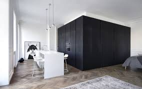 100 Apartments In Moscow INT2architecture Creates Minimalist Black Box To Conceal
