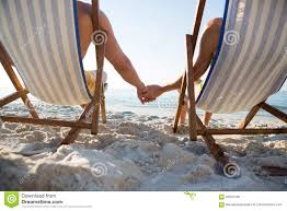 Couple Holding Hands While Relaxing On Lounge Chairs At ... Lounge Chairs On The Beach Man Wearing Diving Nature Landscape Chairs On Beach Stock Picture Chair Towel Cover Microfiber Couple Holding Hands While Relaxing At A Paradise Photo Kozyard Cozy Alinum Yard Pool Folding Recling Umbrellas And Perfect Summer Tropical Resort Lounge Chair White Background Cartoon Illustration Rio Portable Bpack With Straps Of