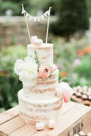 Rock My Wedding You Cant Go Wrong With A Semi Naked Cake Covered In Blooms Macaroons Image By Venue