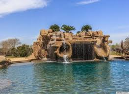 A Stunning Water Slide Waterfall Pool Grotto Combo