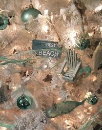 A White Coastal Christmas Tree Joy Works It Is Decked Out With Sea Inspired Metallic Blue Ornaments