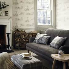 A Scottish Country Manor Living Room We Love The Grey Sofa And Plaid Footstool