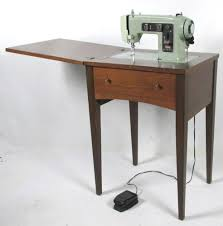 sears kenmore 158 331 sewing machine and cabinet what s it worth